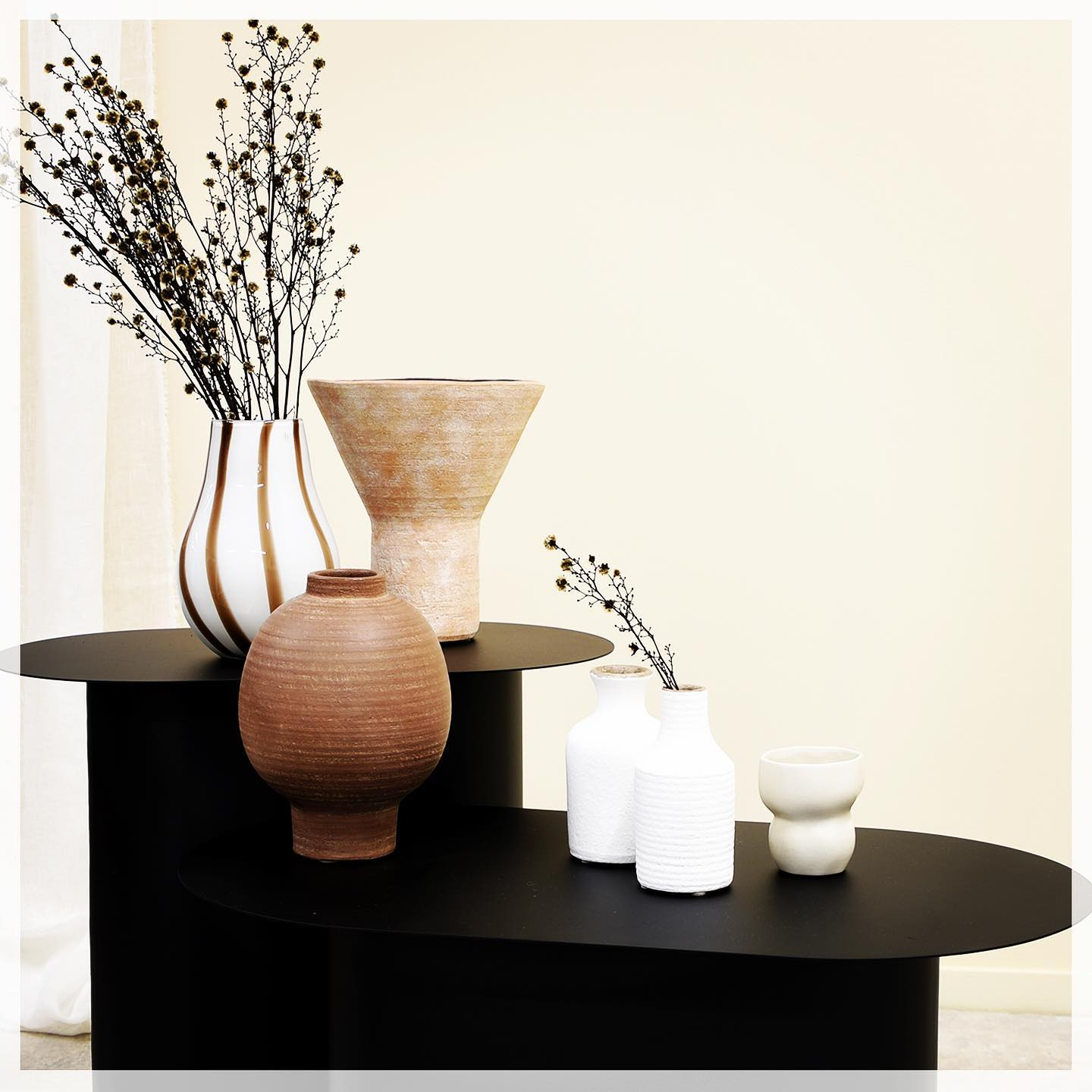 Mixing our very own designs of handmade terracotta pots with Broste's glass vases – a match we thought made for each other. Also our new pair of coffee tables – slim and oval shaped - perfect for those small spaces.  . . #terracottapots #glassvases #coffeetables #sidetables