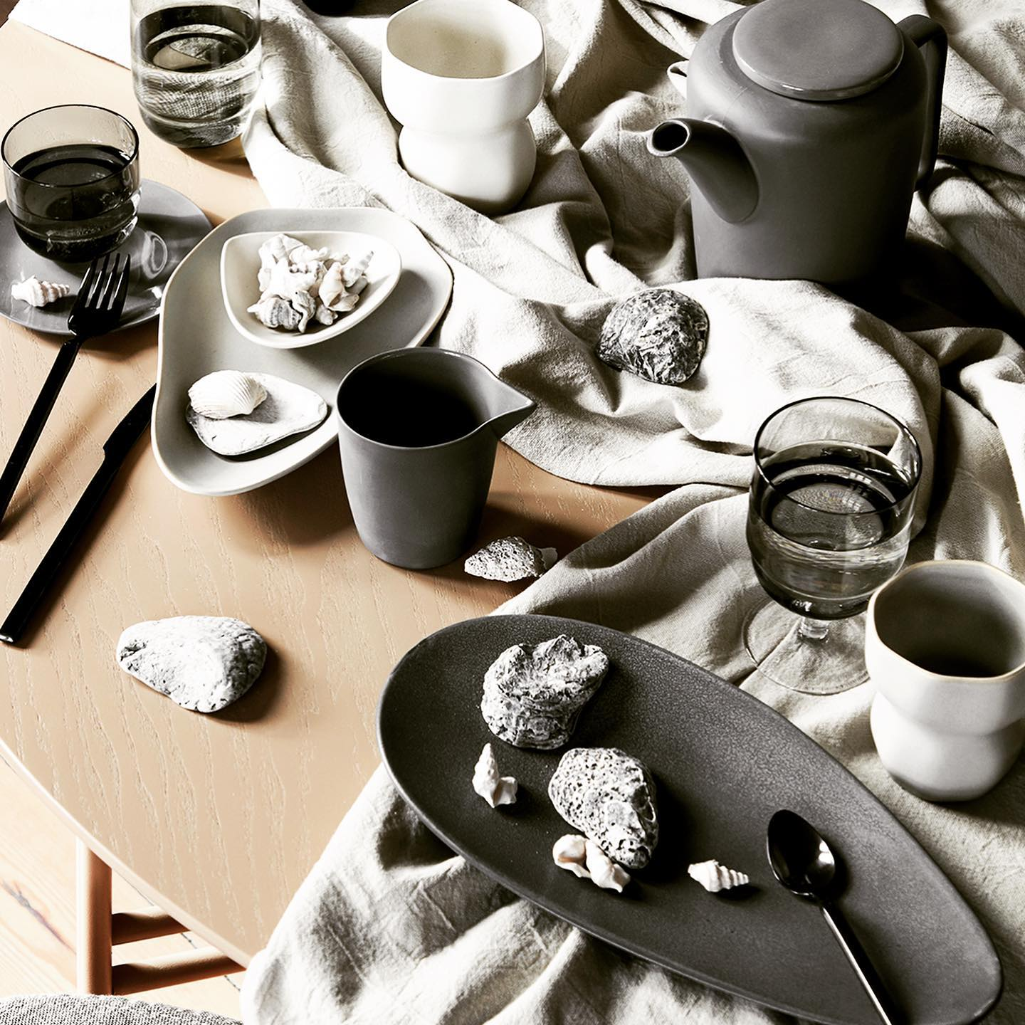Introducing LIMFJORD.  A curvaceous coastline and captivating underworld of limestone unfolds around a unique inlet in the northern part of Denmark, called Limfjorden.  The Limfjord tableware is inspired by the seafloor. The organic shapes and soft tones of the plates, platters and mugs are inspired by the mussels, oysters and cockles from the grand and silent world underneath us.  Each delicate piece is finished with a reactive glaze that gives the ceramics its elegant, watercolour-like texture.  Available in the range: Mugs in 3 colours - beige, light grey and dark grey. A bowl in beige, a small plate in light grey and large plate in dark grey. . . #tableware #serveware #dinnerware